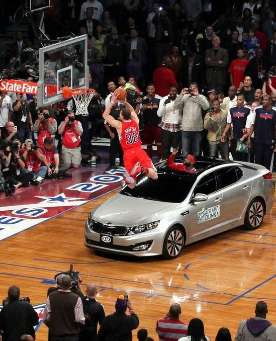 Blake_Griffin_leaps_over_the_car_for_a_dunk_during_the_NBA_Dunk_contest_2011.jpg